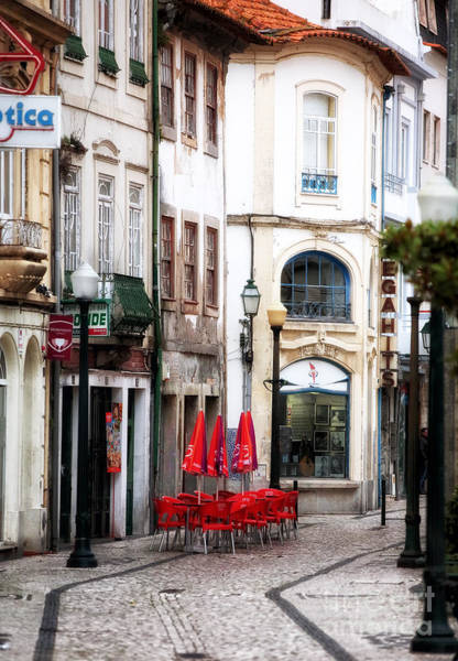 Photograph - Red Chairs In Aveiro by John Rizzuto