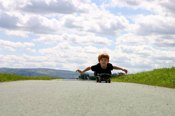 Red Headed Boy Skateboarding Art Print by Image by Catherine MacBride