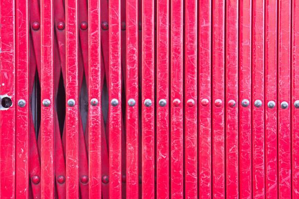 Lock Gates Photograph - Red Metal Bars by Tom Gowanlock