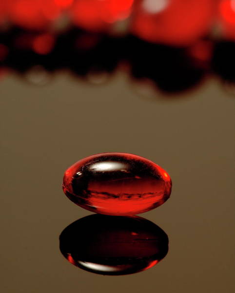 Wall Art - Photograph - Red Nurofen Capsule by Paul Whitehill/science Photo Library