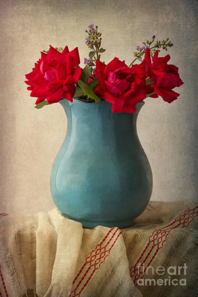 Rose In Bloom Photograph - Red Roses In A Blue Pot by Elena Nosyreva