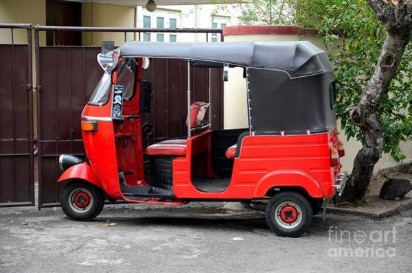 Photograph - Red Three Wheeler Tuk Tuk Rickshaw Parked Outside Gate Colombo Sri Lanka by Imran Ahmed