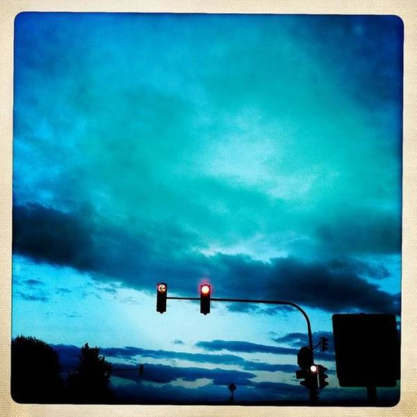 Blue Sky Photograph - Red Traffic Lights And Dark Blue Sky by Matthias Hauser