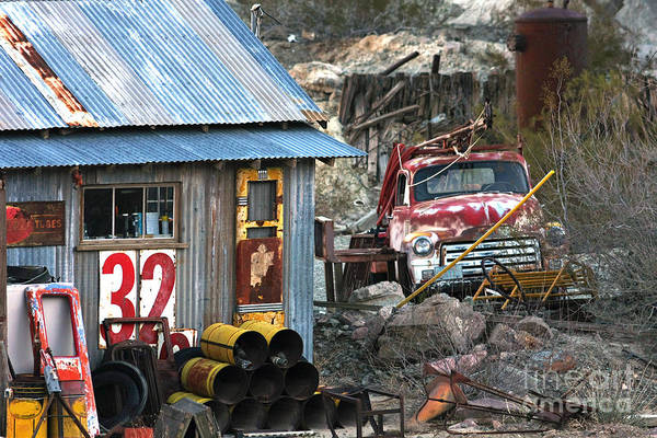 Photograph - Red Vintage Truck Next To Shed by Gunter Nezhoda