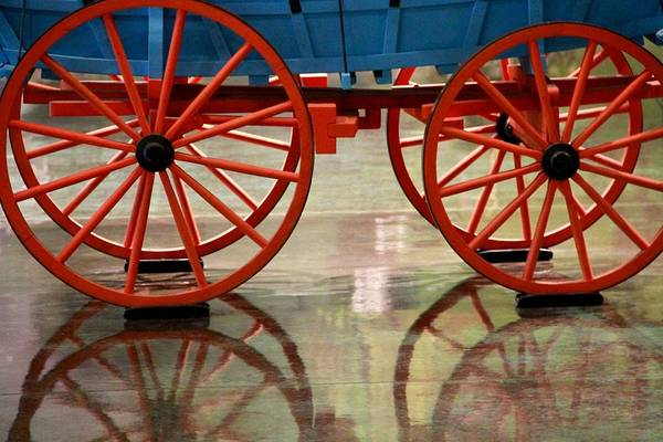 Photograph - Red Wagon Wheel Reflection by Dan Sproul