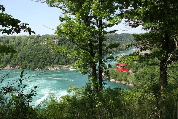 Ropeway Photograph - Red Whirlpool Aero Car by Christiane Schulze Art And Photography