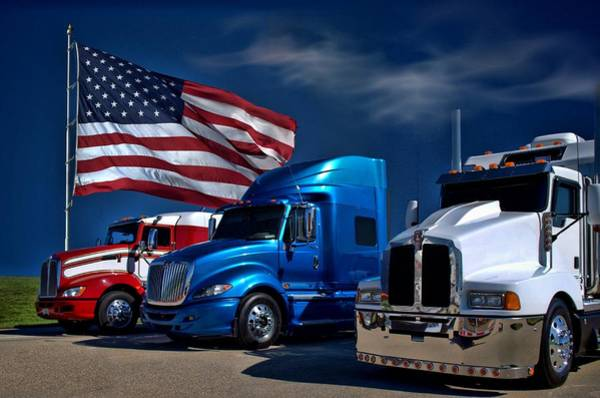 Photograph - Red White And Blue Semi Trucks by Tim McCullough