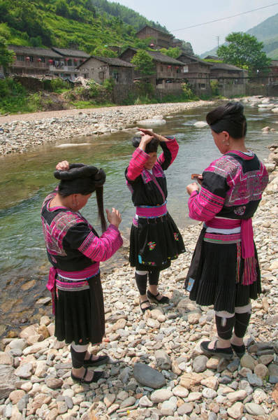 Chinese Clothing Wall Art - Photograph - Red Yao Women Combing Hair Near Stream by Diana Mayfield