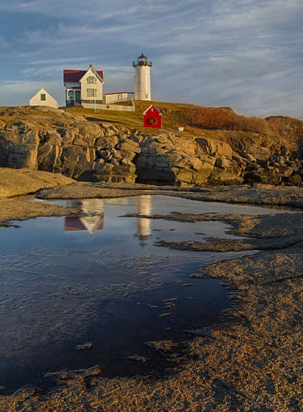Photograph - Reflecting On Nubble Lighthouse by Susan Candelario