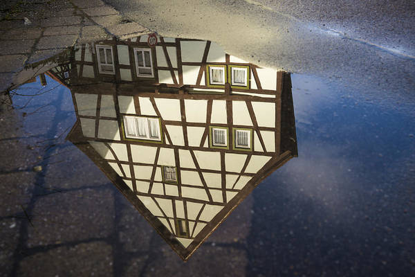 Baden Wuerttemberg Photograph - Reflection Of A Beautiful Old Half-timbered House In A Puddle Of Water by Matthias Hauser