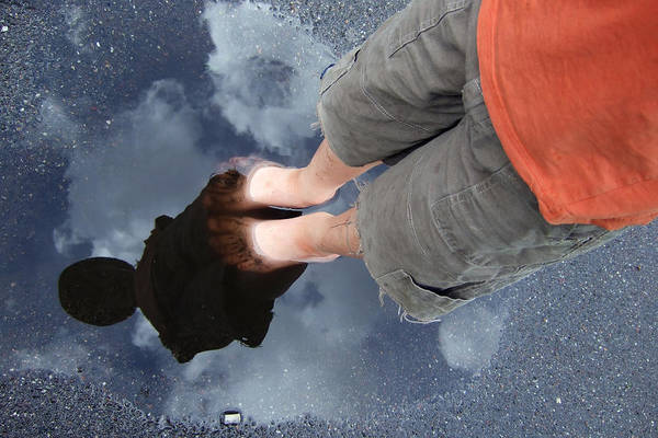 Photograph - Reflection Of Boy In A Puddle Of Water by Matthias Hauser
