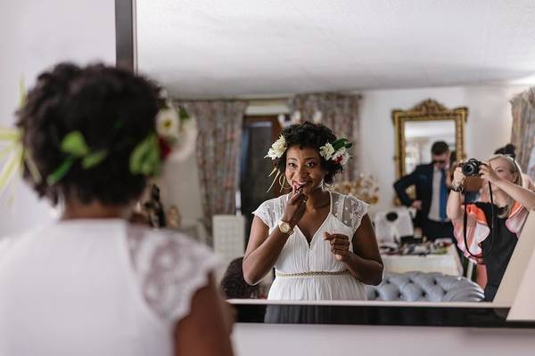 Reflection Of Bride Applying Lipstick While Standing In Front Of Mirror Art Print by Adriana Duduleanu / EyeEm