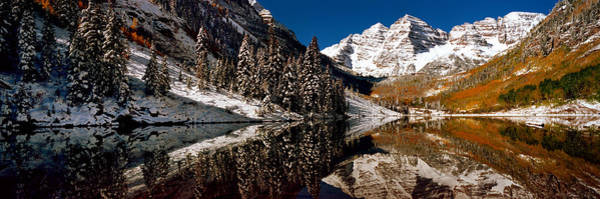Maroon Bells Photograph - Reflection Of Snowy Mountains by Panoramic Images