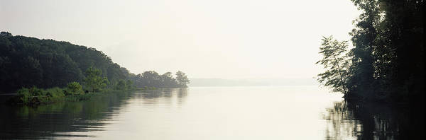 Between The Trees Photograph - Reflection Of Trees In A Lake At Early by Panoramic Images