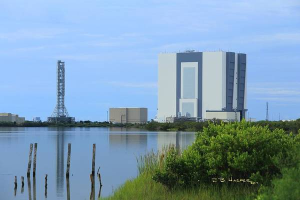 Photograph - Reflections On The Vehicle Assembly Building by R B Harper