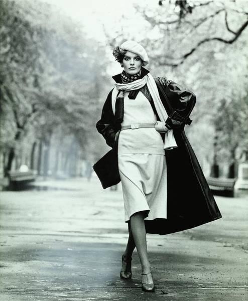 People Walking Photograph - Rene Russo Wearing A Leather Coat by Francesco Scavullo