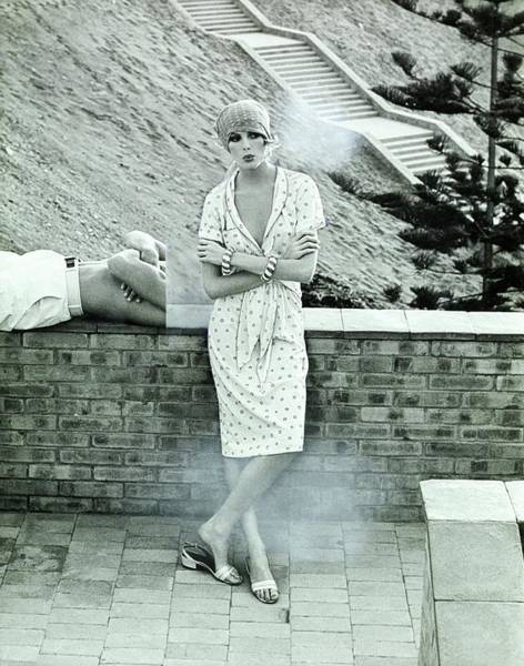 Landscape Architecture Photograph - Rene Russo Wearing A Short-sleeved Print Dress by Henry Clarke