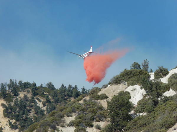 Photograph - Retardant Dropping Airplane by Jeff Lowe