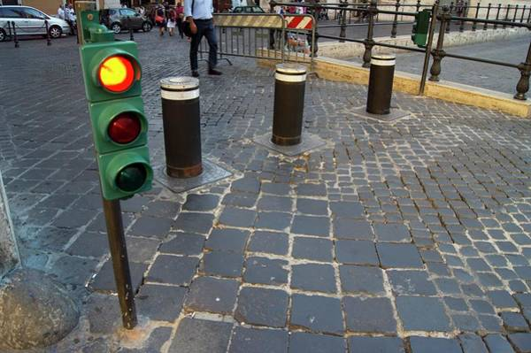 Stop Light Photograph - Retractable Traffic Barrier In Rome. by Mark Williamson