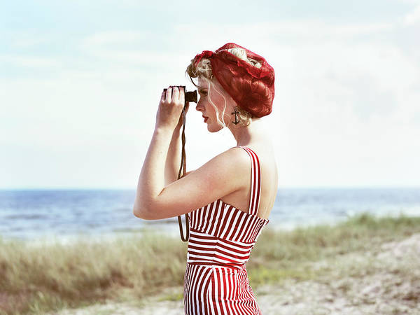 Look Away Photograph - Retro Woman On Beach Looking Through by Johner Images