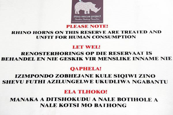 Notice Photograph - Rhinoceros Poaching Notice by Louise Murray/science Photo Library