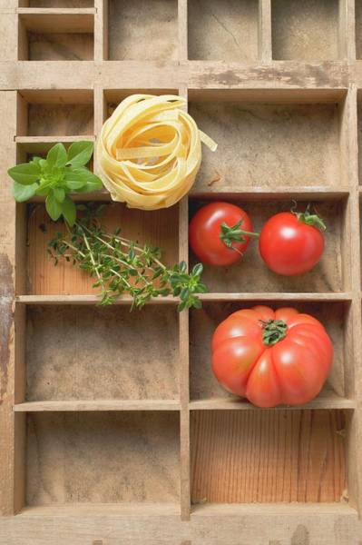 Vegies Photograph - Ribbon Pasta, Tomatoes And Fresh Herbs In Type Case by Foodcollection