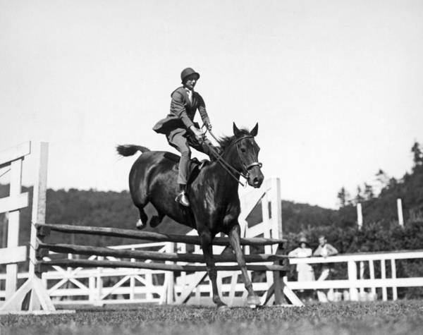 1929 Photograph - Rider Jumps At Horse Show by Underwood Archives