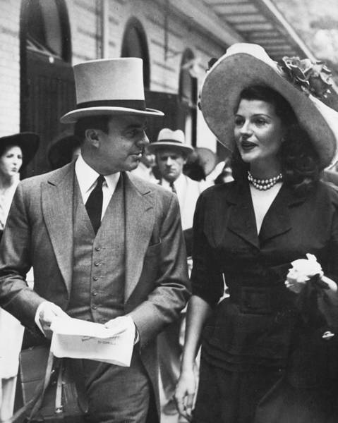 Gene Photograph - Rita Hayworth Walking Down The Street by Retro Images Archive