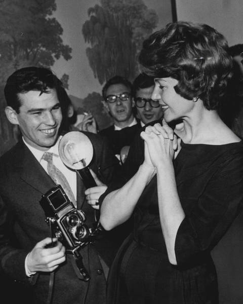 Gene Photograph - Rita Hayworth With Photographer by Retro Images Archive