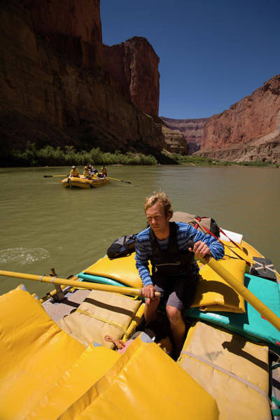 Wall Art - Photograph - River Guide At The Oars Of The Gear by Corey Rich