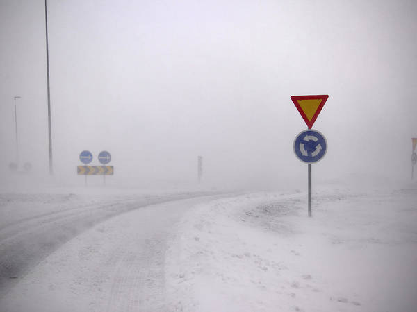 Reykjavik Photograph - Road Signs In Snowy Landscape by Kmm Productions