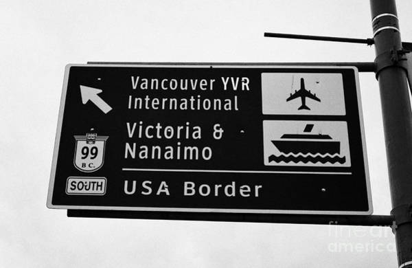 Vancouver International Airport Wall Art - Photograph - roadsign for vancouver airport victoria nanaimo ferries and route 99 south to the USA border Vancouv by Joe Fox