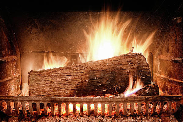 Canadian Culture Photograph - Roaring Log Fire In Cast Iron Hearth by Nicolasmccomber