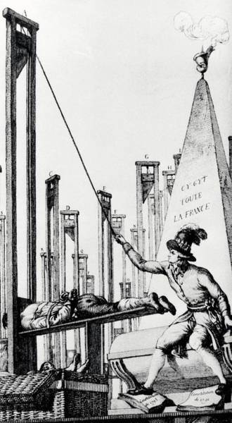Wall Art - Photograph - Robespierre Operating A Guillotine by Science Photo Library