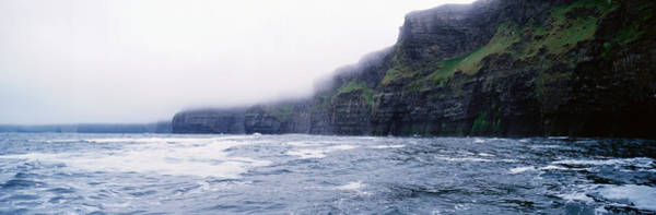 The Burren Photograph - Rock Formations At The Waterfront by Panoramic Images