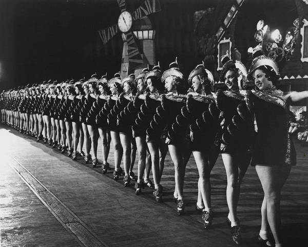 Radio City Music Hall Photograph - Rockettes Brighten Up Manhattan Streets by Retro Images Archive