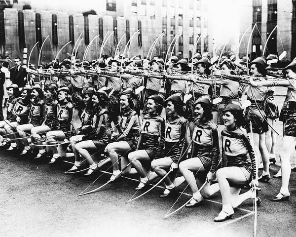 Radio City Music Hall Photograph - Rockettes Do Archery Too by Retro Images Archive