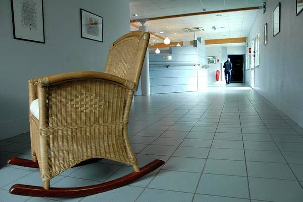 Rocking Chair Wall Art - Photograph - Rocking Chair In A Care Home by Aj Photo/science Photo Library