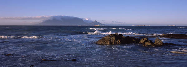 Wall Art - Photograph - Rocks In The Sea With Table Mountain by Panoramic Images