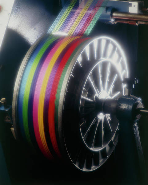 Textile Mill Photograph - Roll Of Coloured Thread At A Weaving Mill by Jesse/science Photo Library
