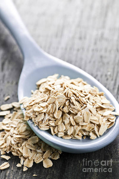Flake Photograph - Rolled Oats In Spoon by Elena Elisseeva
