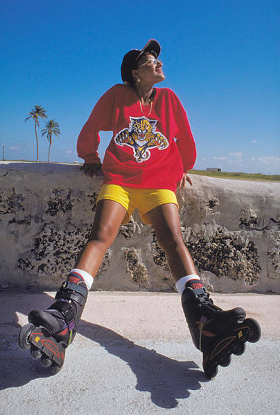 Roller Blades Photograph - Roller Blader In Miami Beach by Carl Purcell