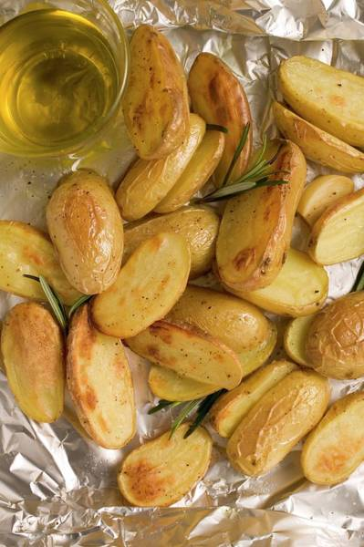Vegies Photograph - Rosemary Potatoes On Aluminium Foil, Olive Oil by Foodcollection