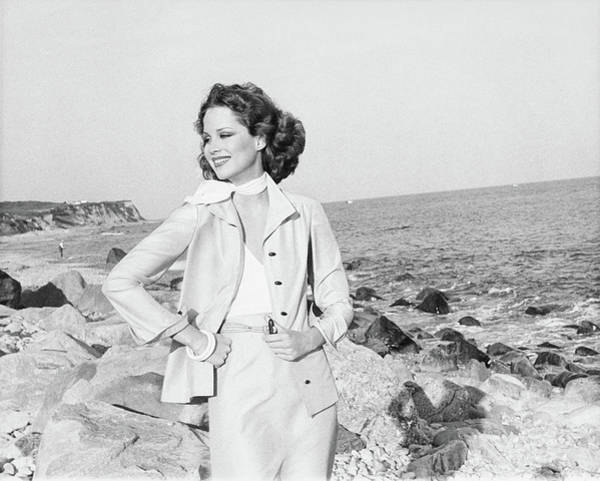 Rosie Wall Art - Photograph - Rosie Vela Wearing A Jacket On A Beach by Francesco Scavullo