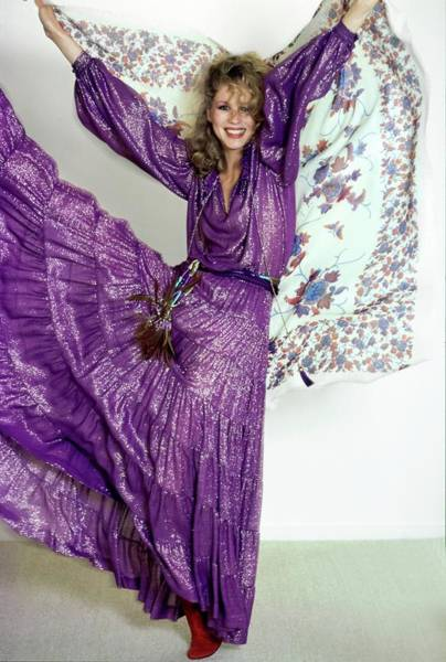 Rosie Wall Art - Photograph - Rosie Vela Wearing A Purple Ensemble by Arthur Elgort