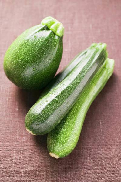 Vegies Photograph - Round And Long Courgettes With Drops Of Water by Foodcollection