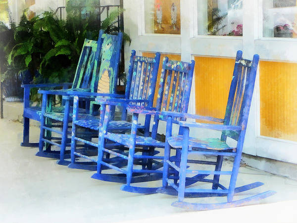 Photograph - Row Of Blue Rocking Chairs by Susan Savad