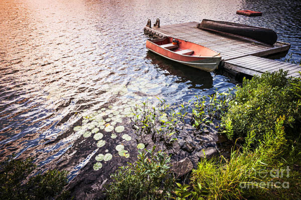 Wall Art - Photograph - Rowboat At Lake Shore At Sunrise by Elena Elisseeva