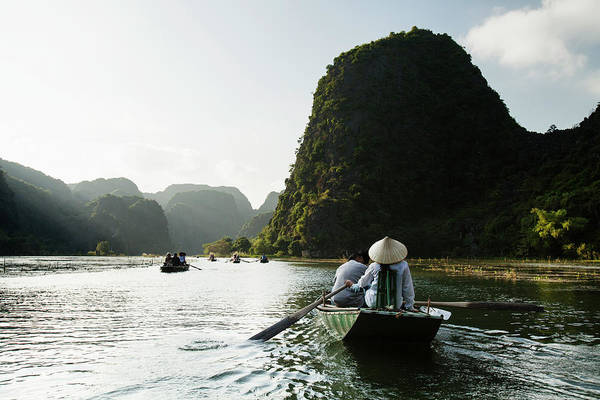 Casual Photograph - Rowboats In Karst Landscape On The Ngo by Tim Gerard Barker