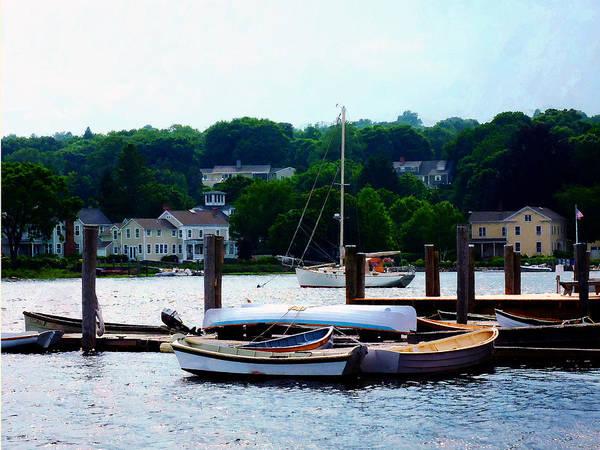 Photograph - Rowboats Piled At Dock by Susan Savad